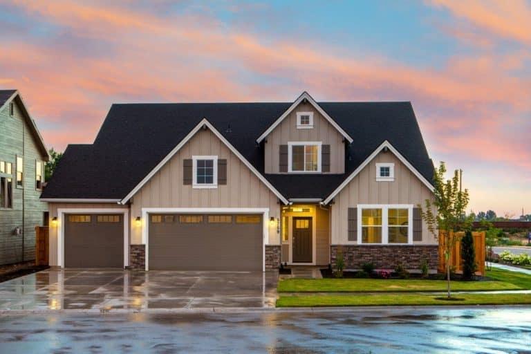 beautiful house with big garage door